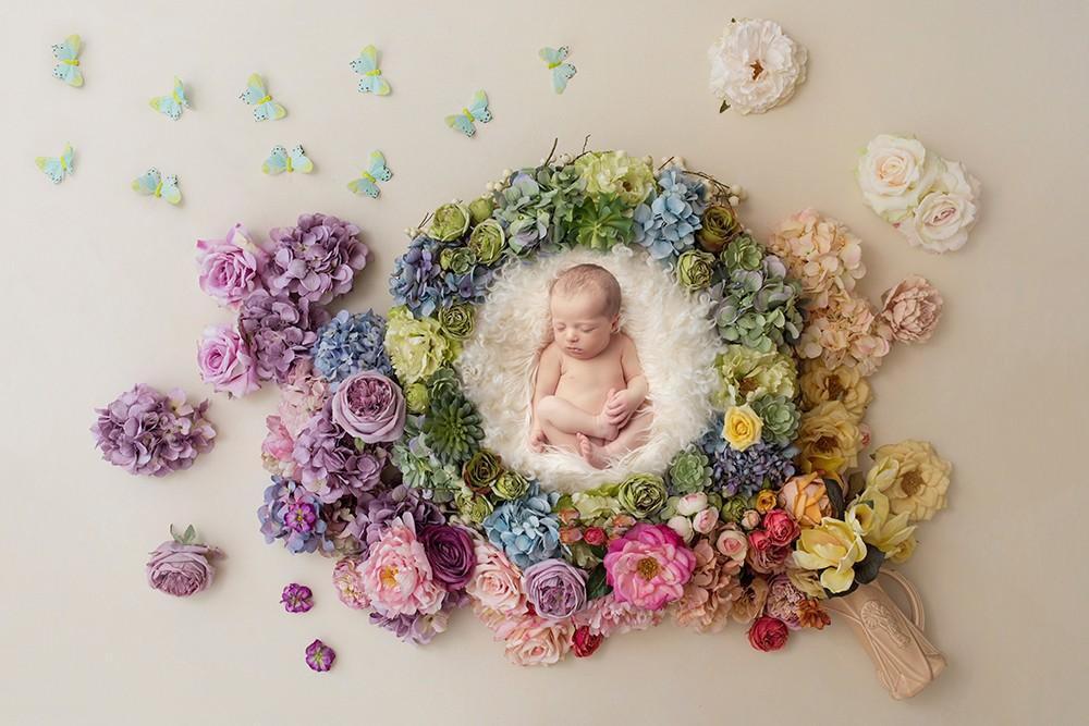 Newborn Photographer rainbow baby with flowers