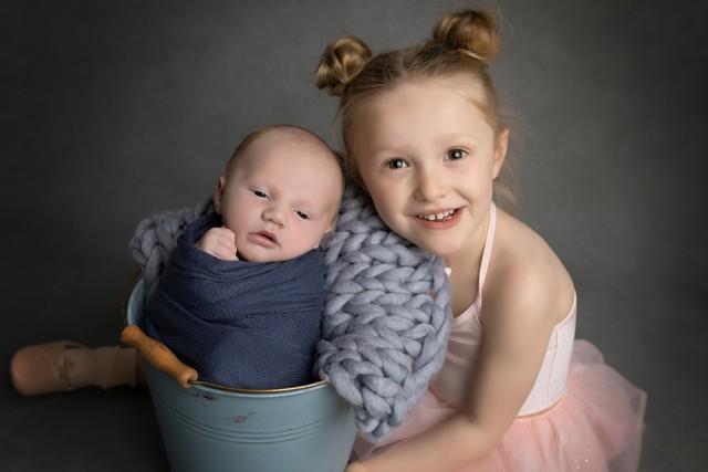 Newborn photographer in Milton Keynes captures image of baby boy with big sister