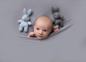 Newborn photographer in Milton Keynes captures image of premature baby boy in grey blanket