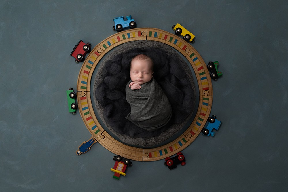 Newborn photographer in Milton Keynes captures image of baby boy with trains
