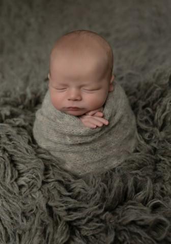 Newborn photographer in Milton Keynes captures image of baby boy in grey rug