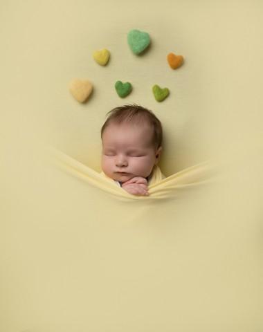 Newborn photographer in Milton Keynes captures image of baby girl with yellow blanket