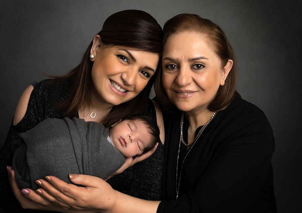 Newborn photographer in Milton Keynes captures image of baby boy with parents and grandparents