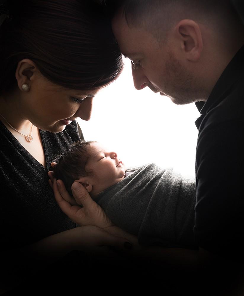 Newborn photographer in Milton Keynes captures image of baby boy with parents