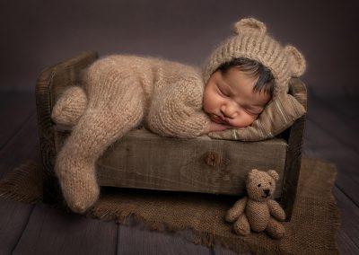Newborn Photographer Northampton Baby in bed prop