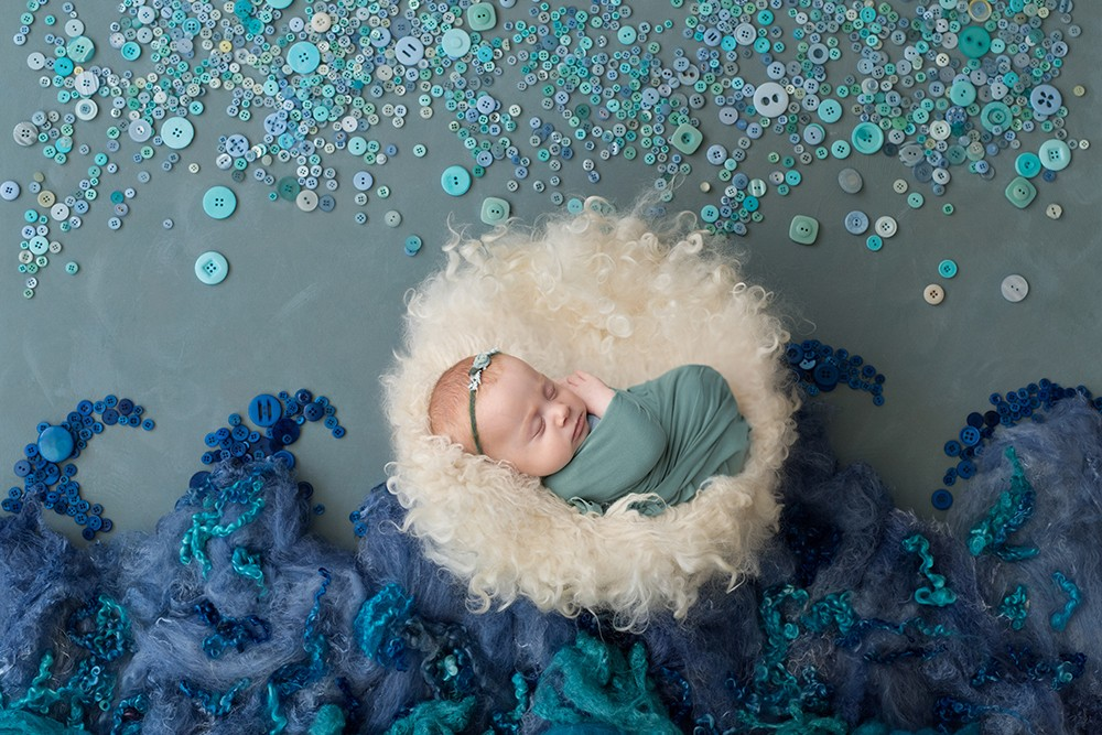 Elaborate ocean styled newborn photograph near Milton Keynes