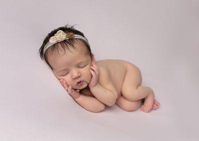 Newborn Photographer in Northampton baby girl rainbow baby in bucket