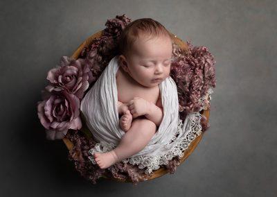 Newborn Photographer Northampton baby girl in pink basket