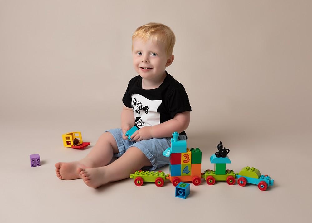 Baby Photographer Bedford captures older baby boy sitter 6 months