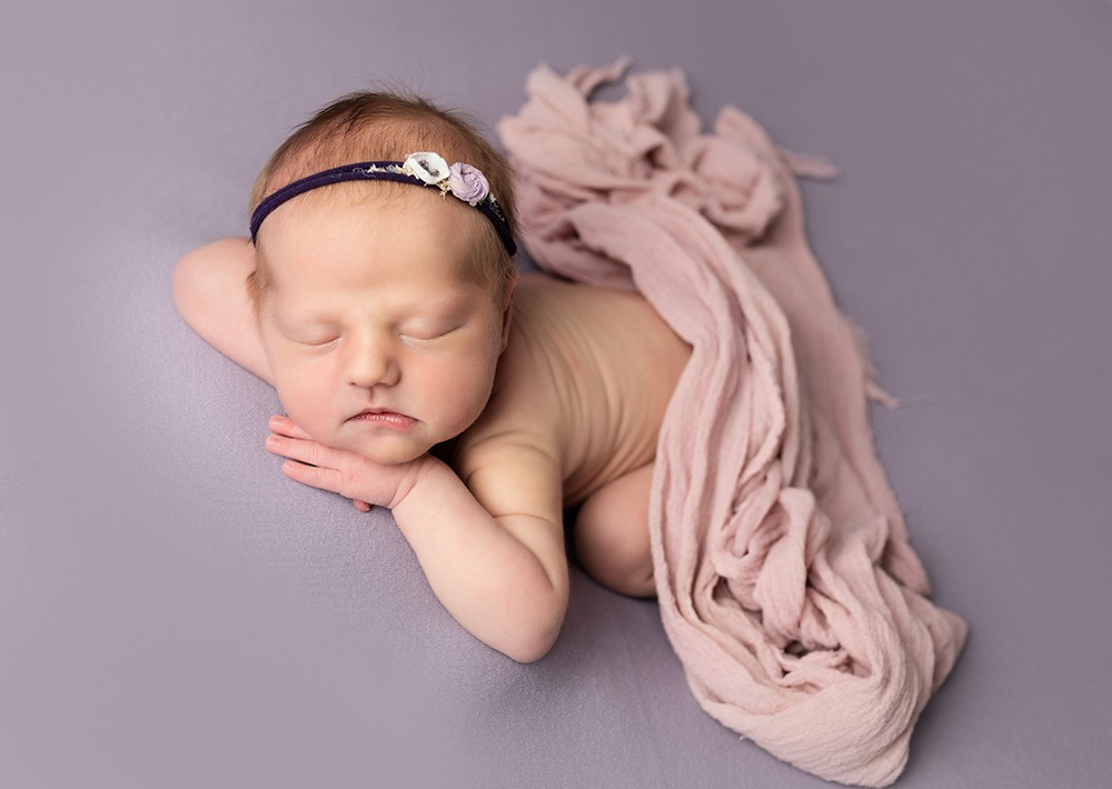 Newborn Photographer in Milton Keynes baby girl with pink and purple