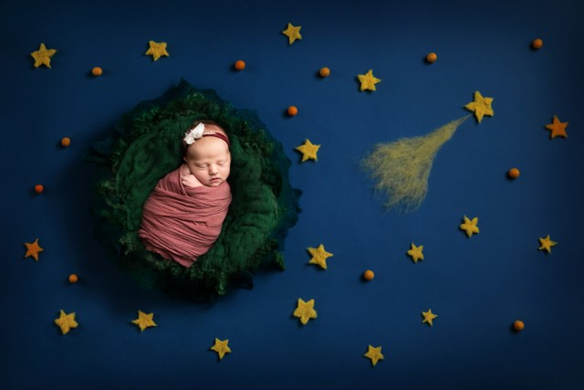 Newborn Photographer in Milton Keynes baby on space background