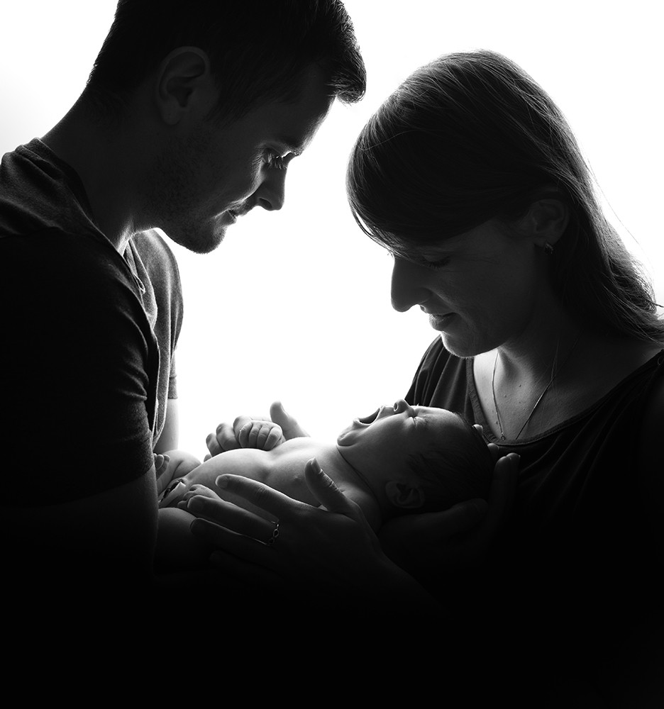 Newborn Photographer in Milton Keynes barents with baby in black and white