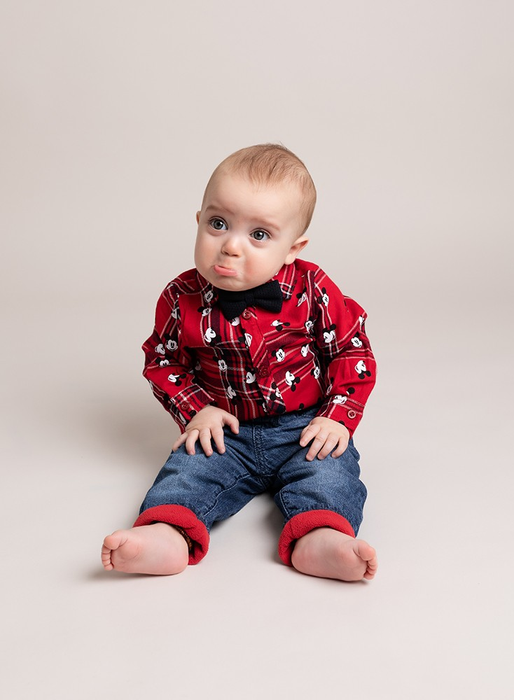 grumpy sitting baby funny photo by baby photographer in Bedford and Milton Keynes