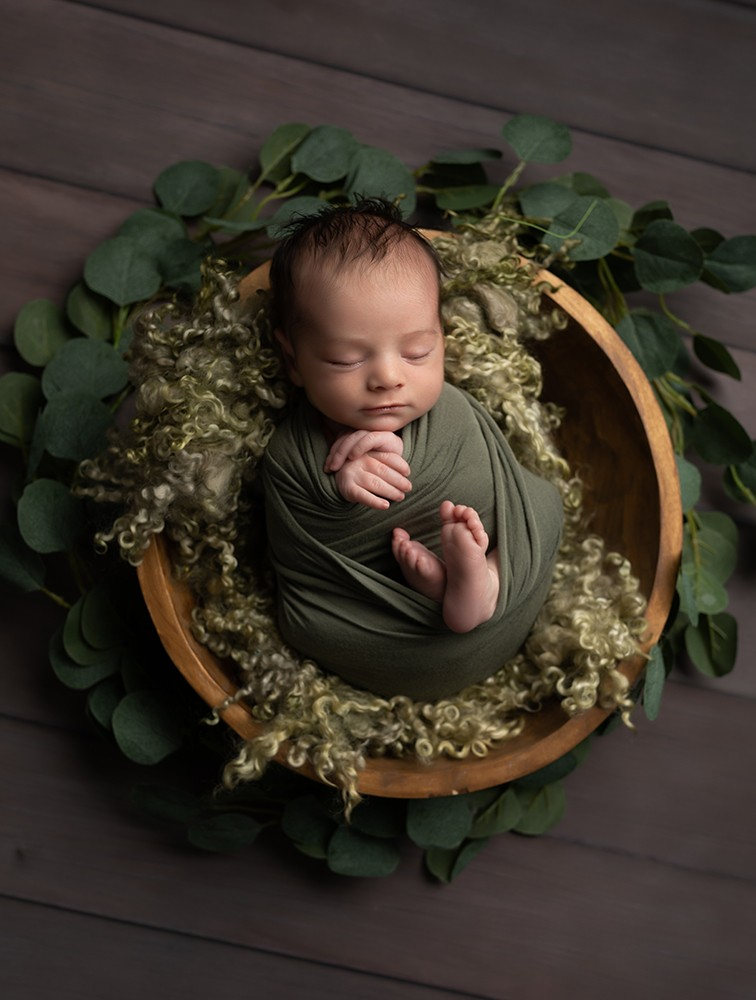 Newborn Photographer in Milton Keynes baby boy in green leaves