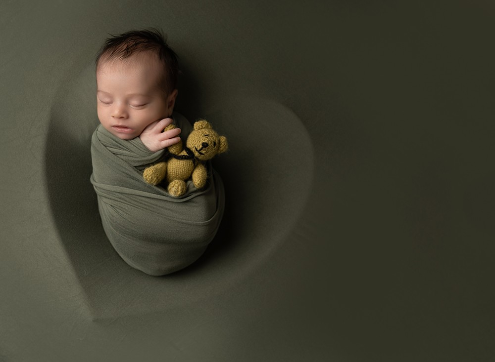 Newborn Photographer in Milton Keynes baby boy on green heart