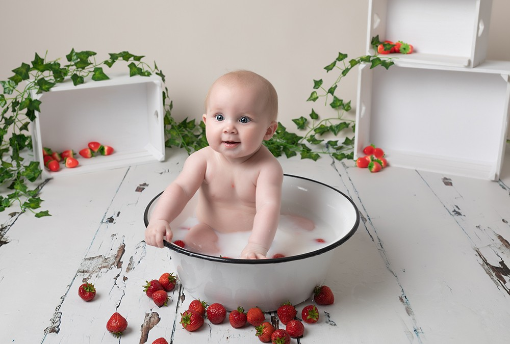 milk bath with fruit by baby photographer in Bedford and Milton Keynes