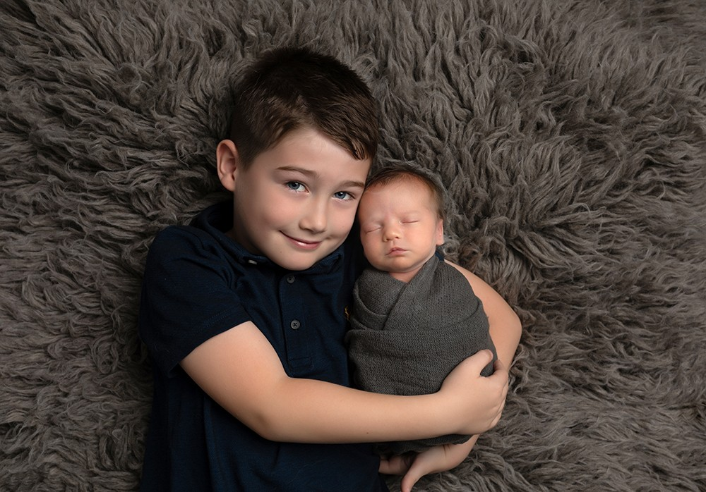 Newborn Photographer in Milton Keynes baby boy with older brother baby photos baby shoot