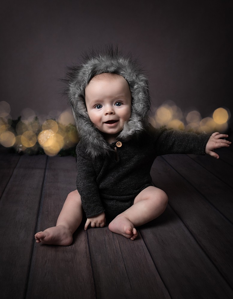 baby boy with big smile 6 months old by baby photographer in Bedford and Milton Keynes