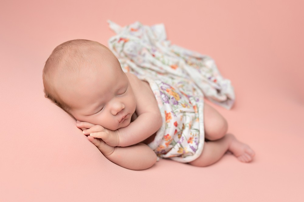 Newborn Photographer in Milton Keynes baby girl with peach and flowers