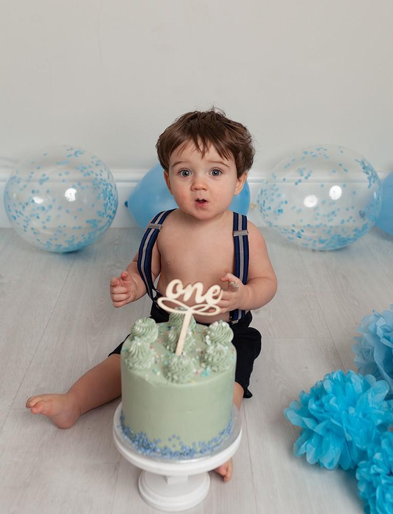 Cake Smash Milton Keynes one year old with blue cake smash near Northampton