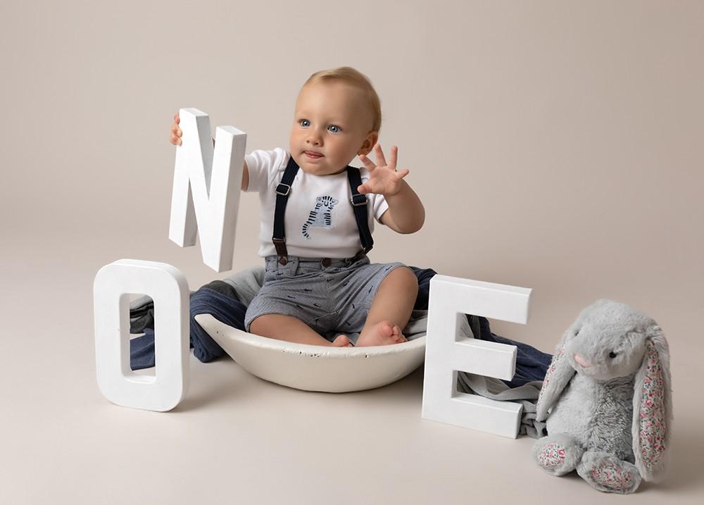 Cake Smash Milton Keynes baby boy first birthday photoshoot near northampton with grey bunny