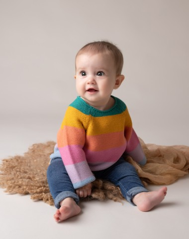 Baby Photographer Bedford baby girl 6 months rainbow jumber