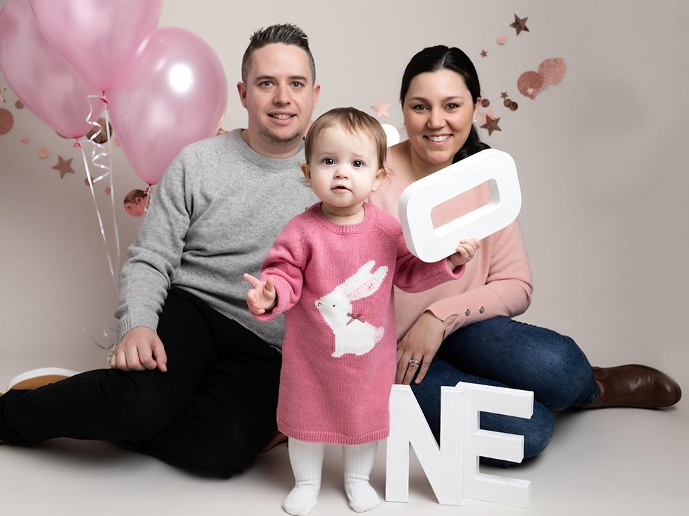 Cake Smash Milton Keynes baby girl with parents at first birthday photoshoot near Northampton