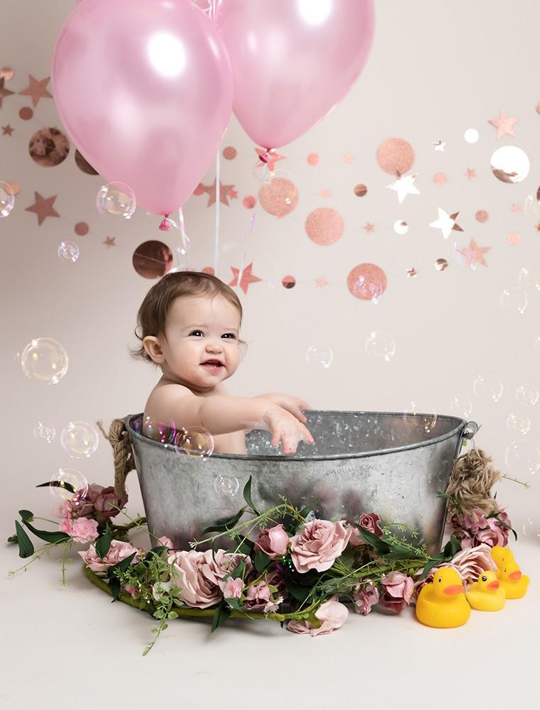 Cake Smash Milton Keynes baby girl in a bath at first birthday photoshoot near Northampton