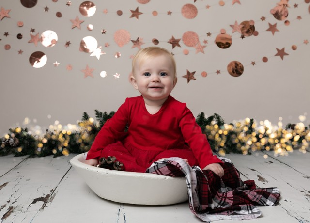 Baby Photographer Bedford baby girl in red with christmas lights