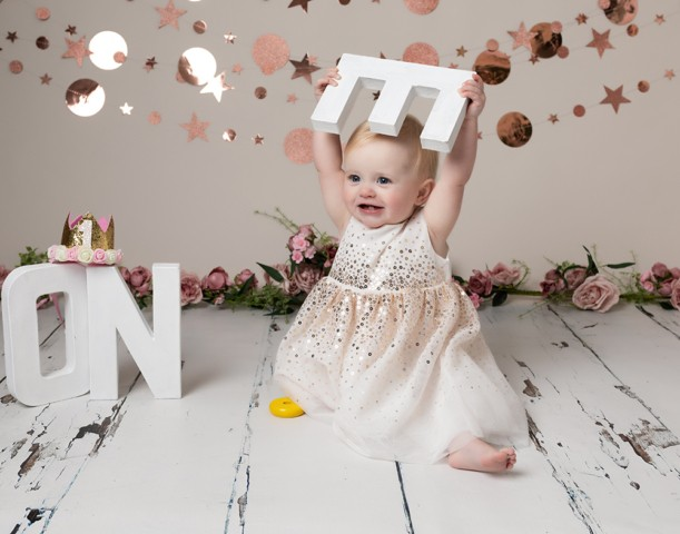 Cake Smash Milton Keynes baby girl at first birthday photoshoot with letters and decorations near Northampton