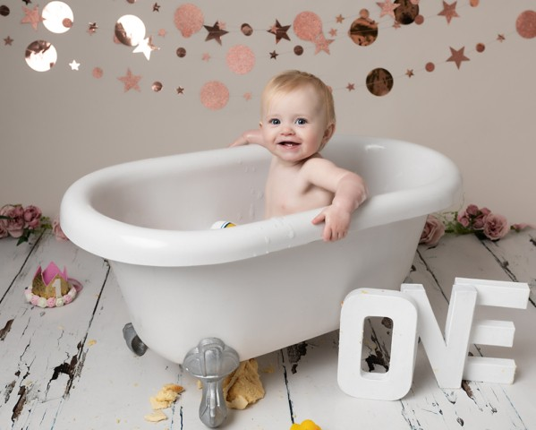 Cake Smash Milton Keynes baby girl in the bath after a first birthday photoshoot