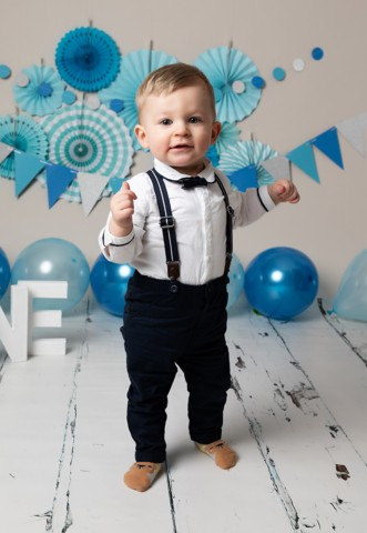 Cake Smash Milton Keynes baby boy with blue decorations on first Birthday photoshoot