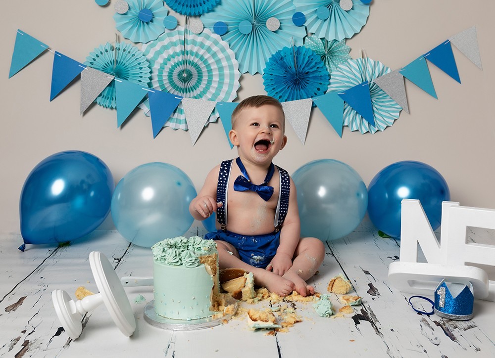 Cake Smash Milton Keynes baby boy first Birthday photoshoot with blue decorations and cake