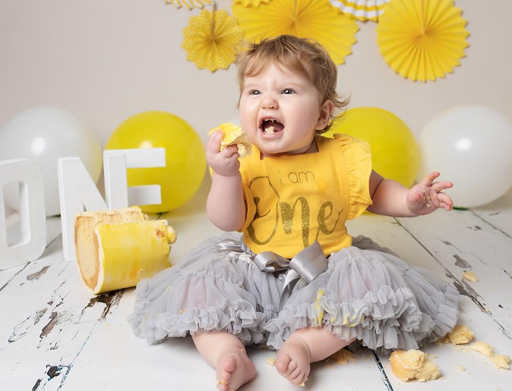 Cake Smash Milton Keynes baby girl yellow cake smash first birthday photoshoot near Northampton
