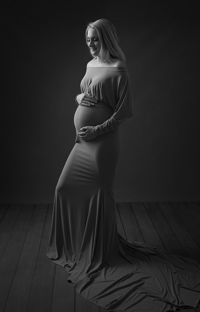 Beautiful pregnant lady blonde girl long dress by Maternity Photographer Milton Keynes and Northampton