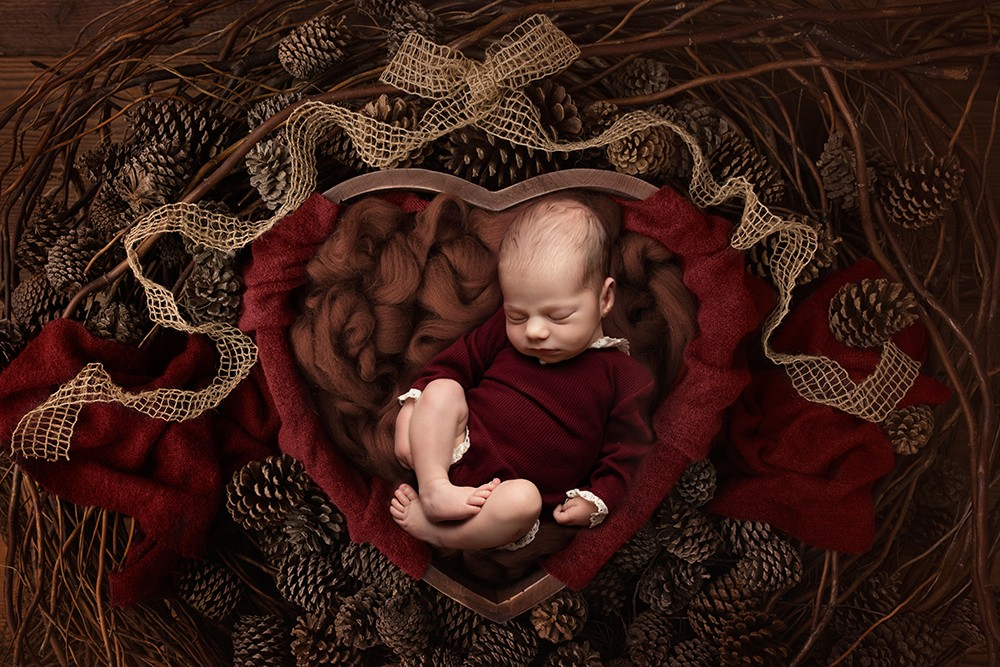 Newborn Photographer in Milton Keynes baby girl in brown and red christmas bowl baby photo from baby photoshoot