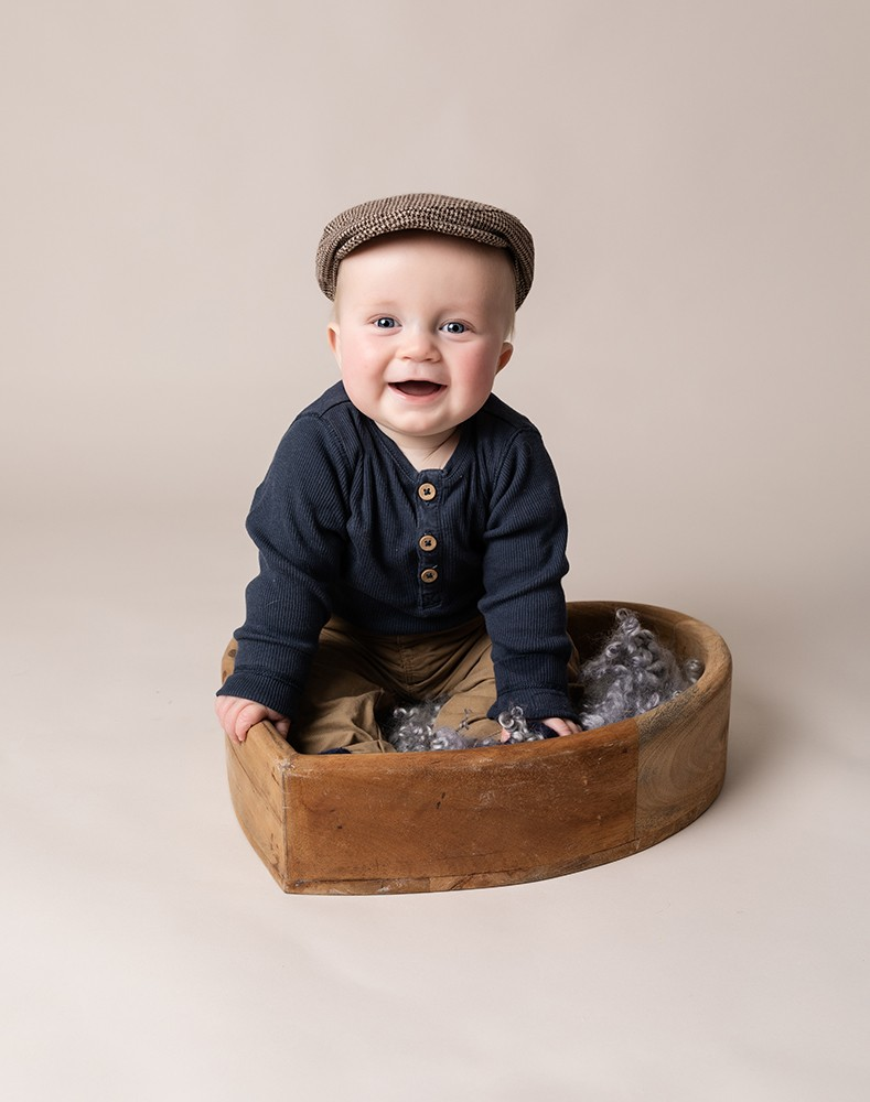 Baby Photographer Bedford baby boy 6 months in a wooden bowl
