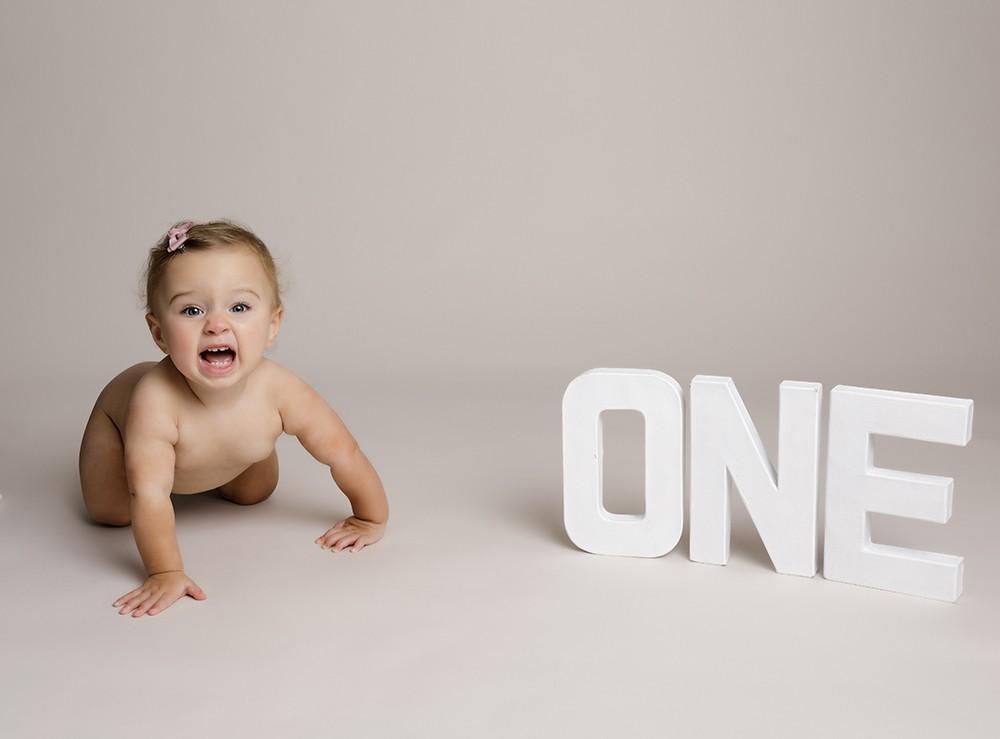 baby girl at first birthday photoshoot in milton keynes