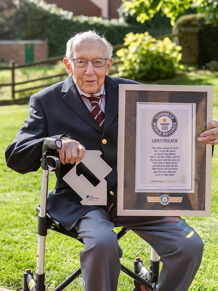 Captain Tom Moore with his trophy for a number one single, and a guinness world record