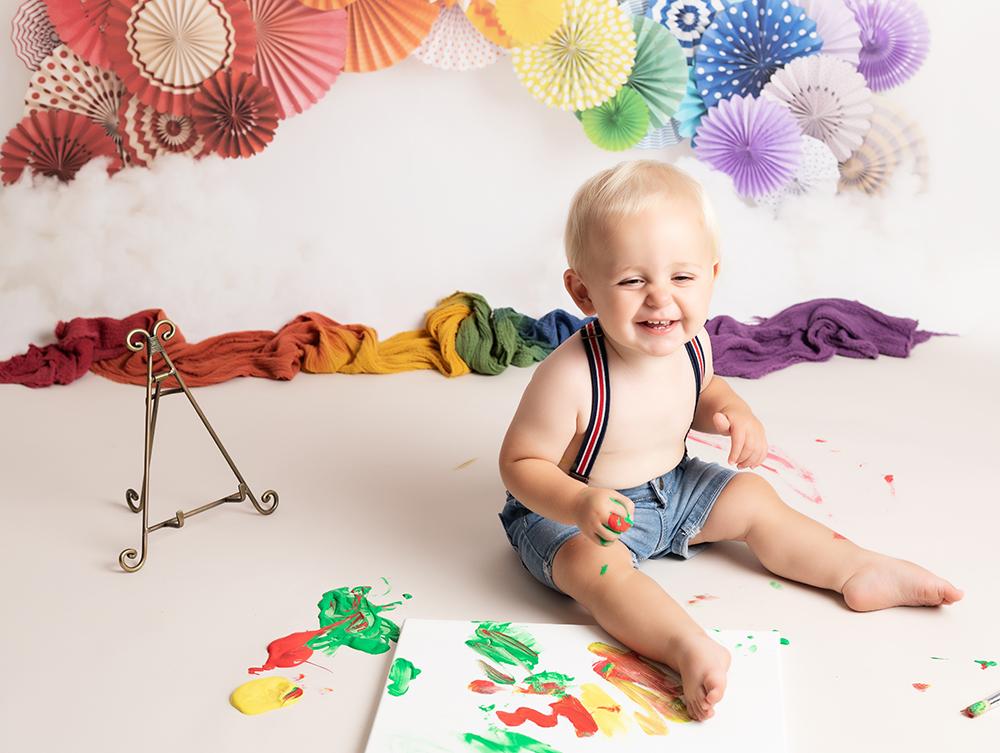 baby boy paint splash first birthday shoot at Cake Smash Milton Keynes