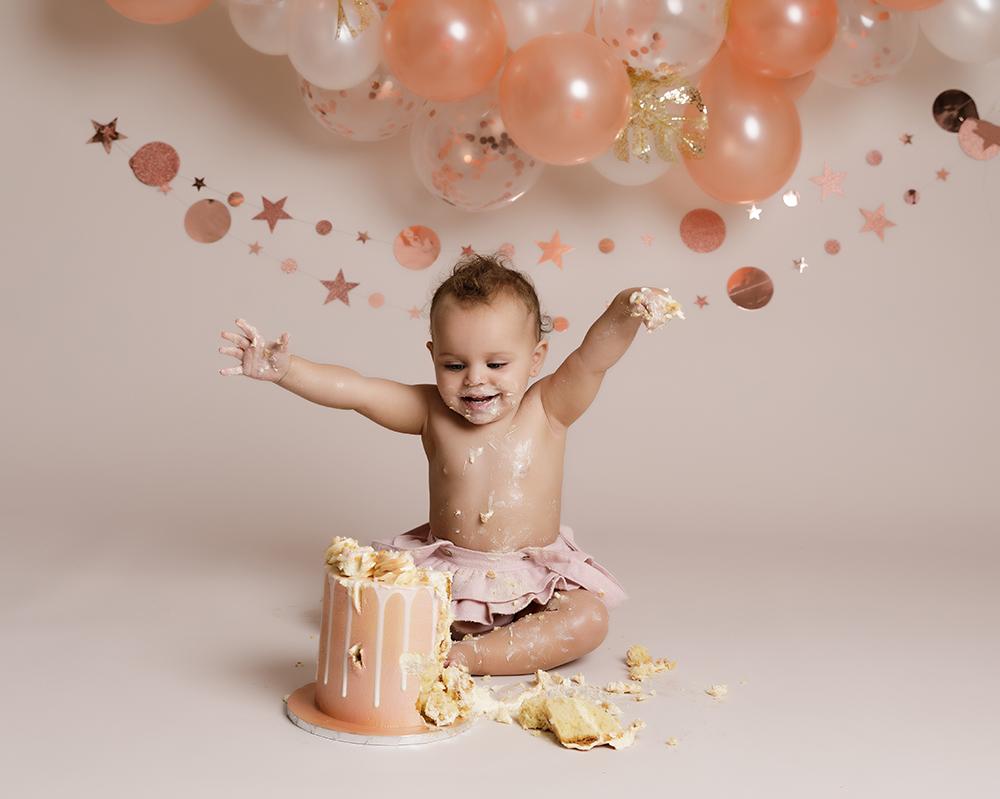 baby girl with rose gold decorations at Cake Smash Milton Keynes