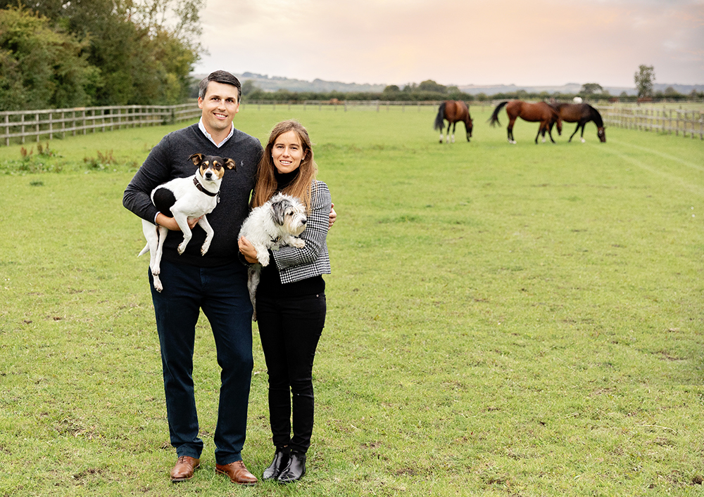 family with dogs and horses  on location photoshoot by family photographer milton keynes