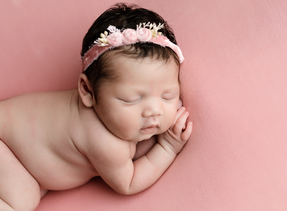 Baby girl on pink blankey sleeping by Newborn Photographer in Milton Keynes and Northampton
