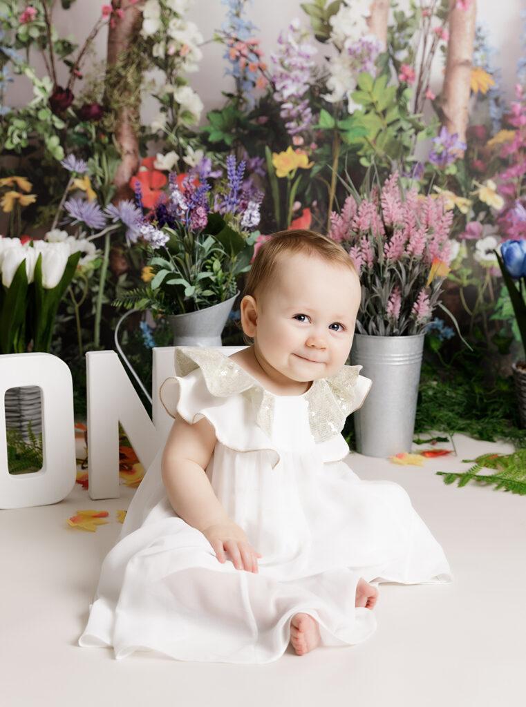 baby girl at floral themed Cake Smash Milton Keynes
