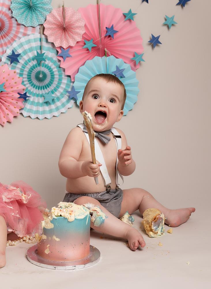 baby boy smiling at Cake Smash Milton Keynes