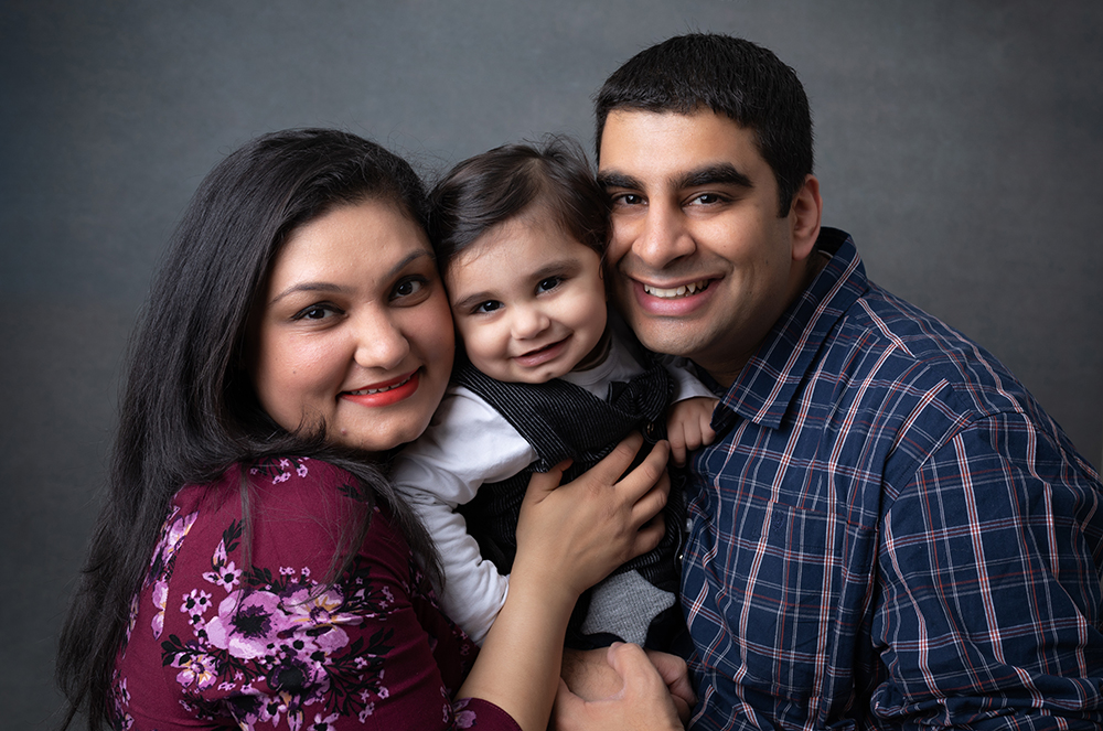 Family with toddler boy in studio by family photographer milton keynes