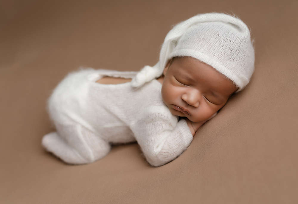 beautiful baby boy sleeping at his photoshoot by Newborn Photographer in Milton Keynes and Northampton