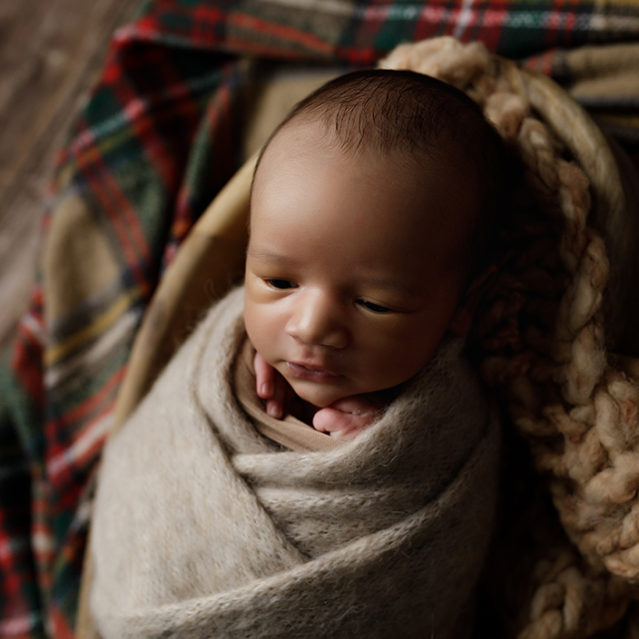 cute newborn baby boy by photographer in Milton Keynes
