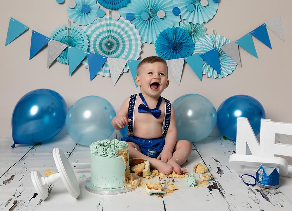 baby boy eating cake at Cake Smash Milton Keynes