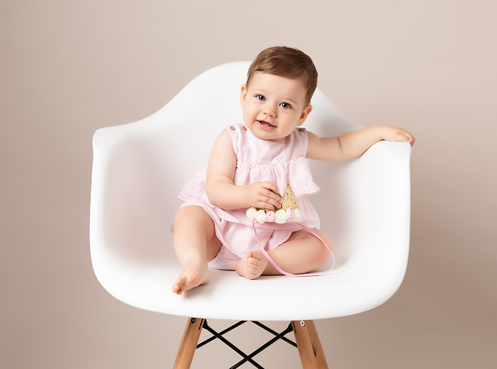 6 month baby by older baby photographer in Bedford
